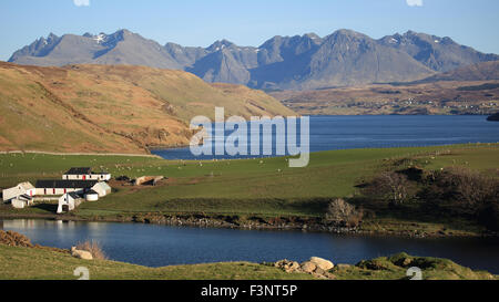 Gesto Farm with Loch Harport between the farm and the Cuillin Mountains, Isle of Skye, inner Hebrides, Scotland