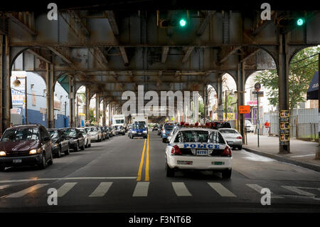 Typical landscape of Queens, in meters high above the road and police cars guarding the area. This area owes its - Stock Photo