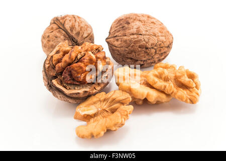 Whole and peeled nuts isolated on white. - Stock Photo