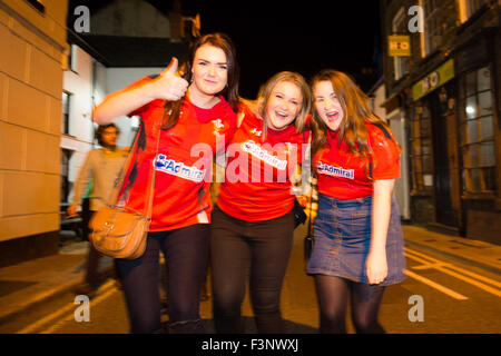 Aberystwyth Wales Uk, Saturday 10 October 2015  Three Welsh football  fans outside the Llew Du pub  Hotel in Aberystwyth - Stock Photo
