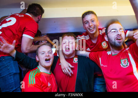 Aberystwyth Wales Uk, Saturday 10 October 2015  Welsh football  fans in the Llew Du pub  Hotel in Aberystwyth celebrate - Stock Photo