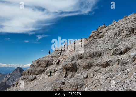 Climbers heading to the summit of Piz Boe in the Sella Group of the Dolomites of Italy - Stock Photo