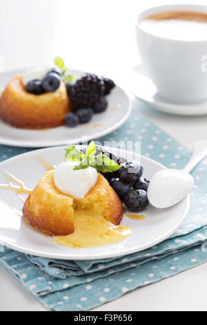 White chocolate lava cake with blueberries and blackberries - Stock Photo