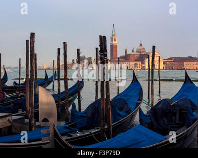 Gondola's parked on the Grand Canal with San Giorio Maggiore in the background, Venice - Stock Photo