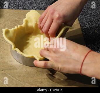 Making Savoury pie quiche - Stock Photo