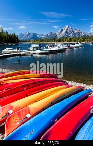 Teton Range; colorful boats; Colter Bay Marina; Jackson Lake; Grand Teton National Park; Wyoming; USA - Stock Photo