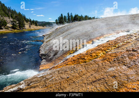 Midway Geyser Basin; hot springs flow to Firehole River; Yellowstone National Park, Wyoming, USA - Stock Photo