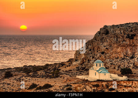 The sunset in Finiki of Karpathos, Greece - Stock Photo