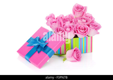 Gift box full of pink roses. Isolated on white background - Stock Photo