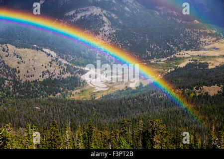 Full; vibrant; rainbow; Rainbow Curve; Rocky Mountain National Park; Colorado; USA - Stock Photo