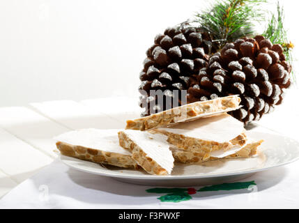 traditional Christmas sweet in Spain call turron and it is made of almonds, honey, and eggs, on a wooden table with - Stock Photo