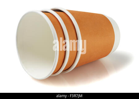 Disposable Paper Coffee Cups Lying on White Background - Stock Photo