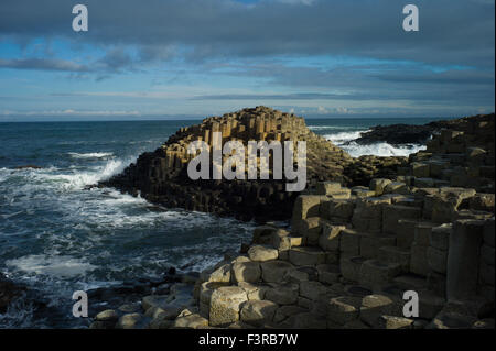 Golden rocks at the UNESCO World Heritage site, GIANTS CAUSEWAY, Bushmills, Antrim, Ireland - Stock Photo
