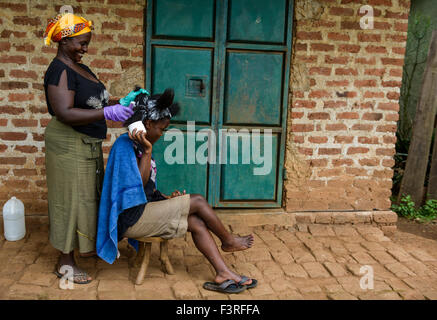 Hairdresser in a village, Uganda, Africa - Stock Photo