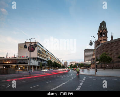 Bikinihaus and Kaiser Wilhelm Memorial Church, Charlottenburg, Berlin, Germany - Stock Photo