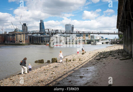 People along the River Thames, Southwark, London, United Kingdom - Stock Photo