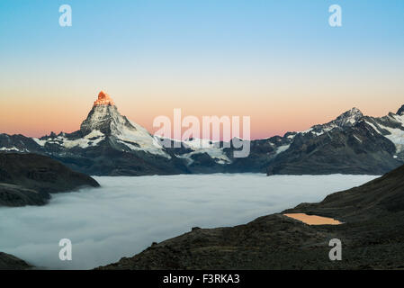 Matterhorn with clouds at sunrise, Switzerland - Stock Photo