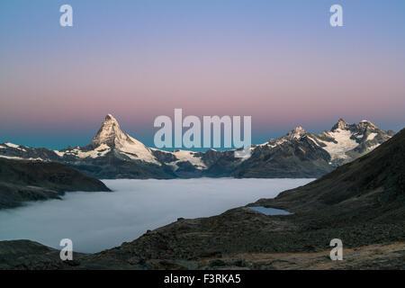 Matterhorn with clouds at dawn, Switzerland - Stock Photo