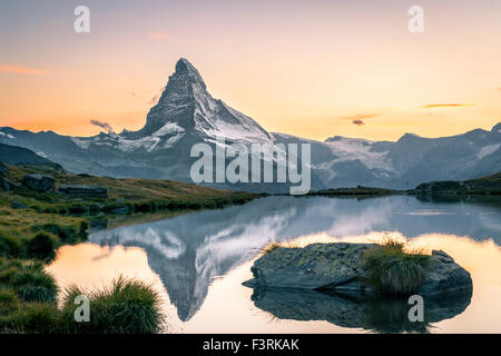 The Matterhorn reflected in Stellisee at sunset - Stock Photo