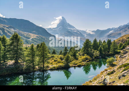 The Grindjisee with view of the Matterhorn - Stock Photo