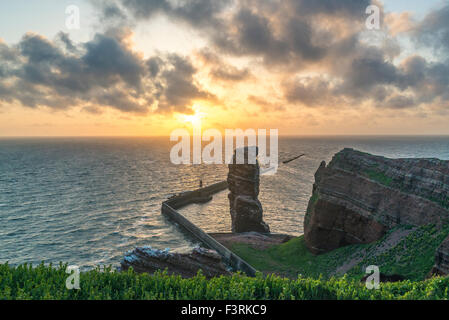Rock Formation 'Lange Anna' at sunset, Helgoland, Schleswig-Holstein, Germany - Stock Photo