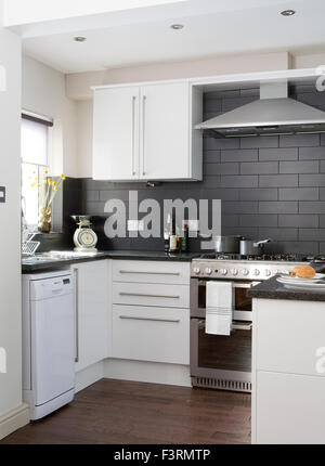 black tiled kitchen - Stock Photo