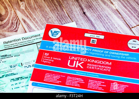 Retention document private number plate and v5c car registration certificate log book owner ownership proof UK england - Stock Photo