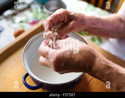 Senior woman baking - Stock Photo