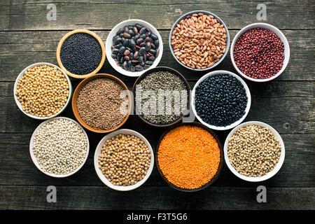 various legumes in different bowls - Stock Photo