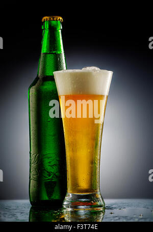 Beer glass in fornt of black background - Stock Photo