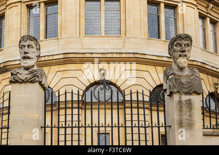 Emperor's Heads outside the 17th century Sheldonian Theatre at Broad Street in Oxford Oxfordshire England United - Stock Photo