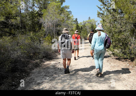 Walkers walking with backpacks on a path in the Besparmak Mountains in North Cyprus  KATHY DEWITT - Stock Photo