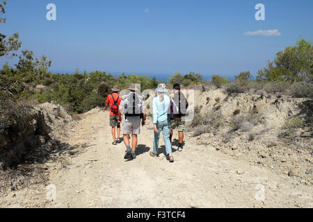 Walkers walking with backpacks on a path near the Kaplica Coast in North Cyprus  KATHY DEWITT - Stock Photo