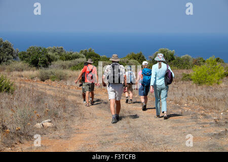 Rear view of  Explore walking group heading to the Kyrenia coast in September autumn in Turkish North Cyprus  KATHY - Stock Photo