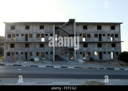 Exterior view of an empty apartment building on construction site in North Cyprus  KATHY DEWITT - Stock Photo