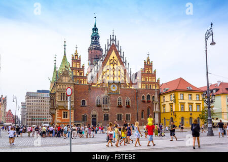Old Town Hall and People walking in the Old Town, Market Square,  Wroclaw, Poland, Europe, Summer 2015 - Stock Photo