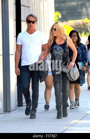 Fashion Designer Lloyd Klein and socialite Jocelyn Wildenstein out and about in Beverly Hillsarm in arm as they - Stock Photo