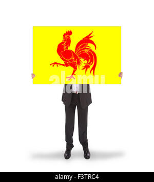 Smiling businessman holding a big card, flag of Wallonia, isolated on white - Stock Photo