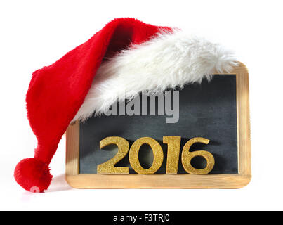 santa klaus hat on a slate with golden figures 2016 - Stock Photo