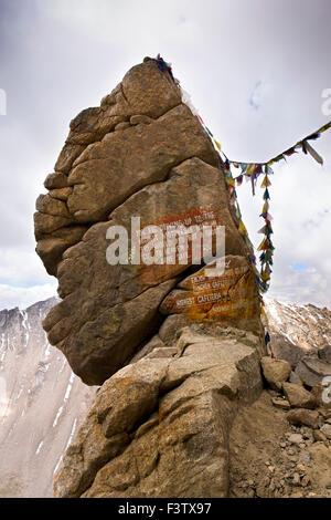 India, Jammu & Kashmir, Ladakh, Leh, Khardung La Pass, road safety notice painted on precarious rock - Stock Photo