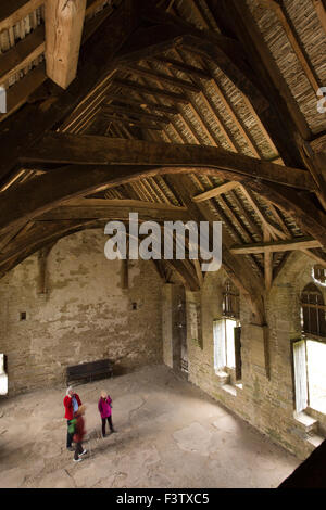 UK, England, Shropshire, Craven Arms, Stokesay Castle, visitors inside Great Hall looking at roof - Stock Photo