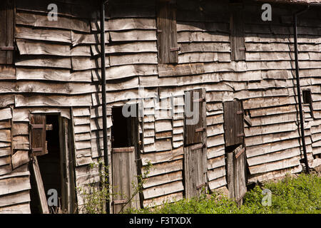 UK, England, Shropshire, Craven Arms, old oak clad farm outbuildings beside Stokesay Castle - Stock Photo