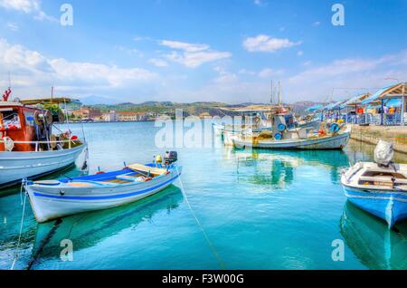 A view of the port and coastline in Gythion, a very picturesque town in Peloponnesos, Greece. Many boats are embarked - Stock Photo