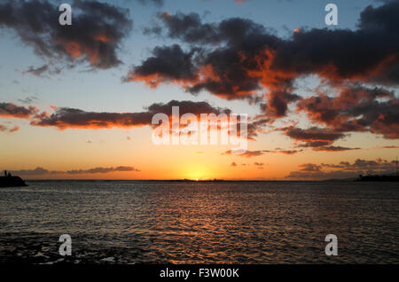 Honolulu, Hawaii. 1st Oct, 2015. Wide-angle view of beautiful afternoon clouds over the ocean viewed from Ala Moana - Stock Photo