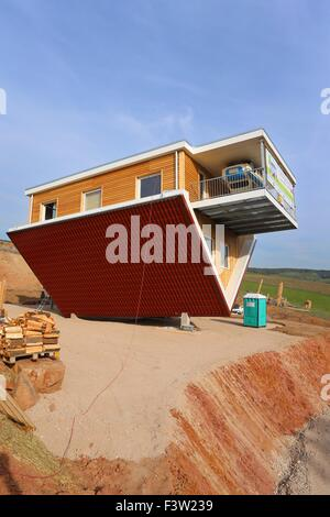 An upside-down house and carport
