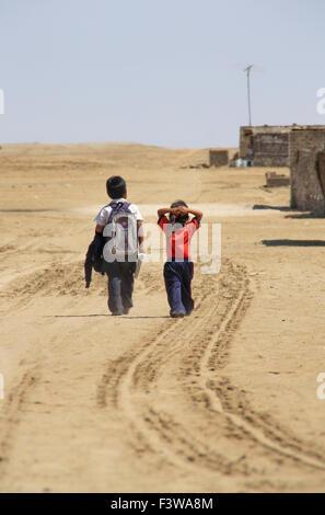 Schoolchildren in the desert - Stock Photo