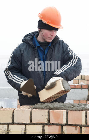 Brick layer worker builder mason - Stock Photo