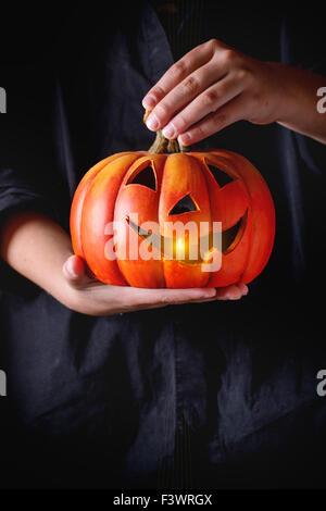 Halloween Pumpkin lantern in child's hands