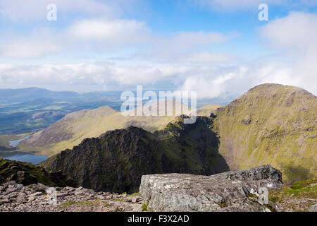 Beenkeragh and ridge from Carrauntoohil in MacGillycuddy Reeks, Killarney, County Kerry, Eire, Southern Ireland - Stock Photo