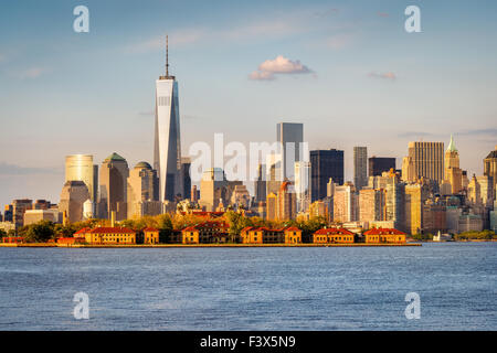 New York Harbor view of the World Trade Center and Lower Manhattan with Financial District skyscrapers and Ellis - Stock Photo